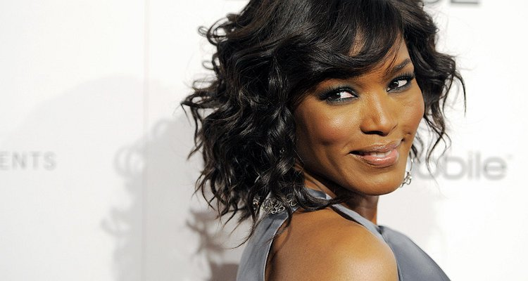 "FILE - In this Feb. 24, 2011 file photo, honoree Angela Bassett arrives at Essence magazine's Black Women in Hollywood luncheon in Beverly Hills, Calif. Bassett is turning heads on Broadway playing  Camae, a mysterious motel maid who delivers coffee to civil rights leader Martin Luther King Jr. in Katori Hall's play ""The Mountaintop.""  (AP Photo/Chris Pizzello, file)"
