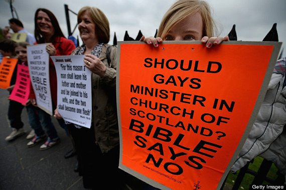 EDINBURGH, SCOTLAND - MAY 20:  Protestors demonstrate with placards outside the entrance to the Church of Scotland General Assembly on May 20,2013 in Edinburgh, Scotland. Members will be discussing whether to allow people in same sex relationships to be ordained as Ministers in the Church of Scotland.  (Photo by Jeff J Mitchell/Getty Images)
