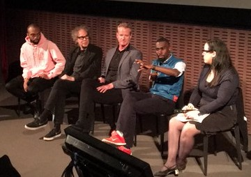 Deray (2nd from right) and Dan (center) speaking at a panel in May 2016.