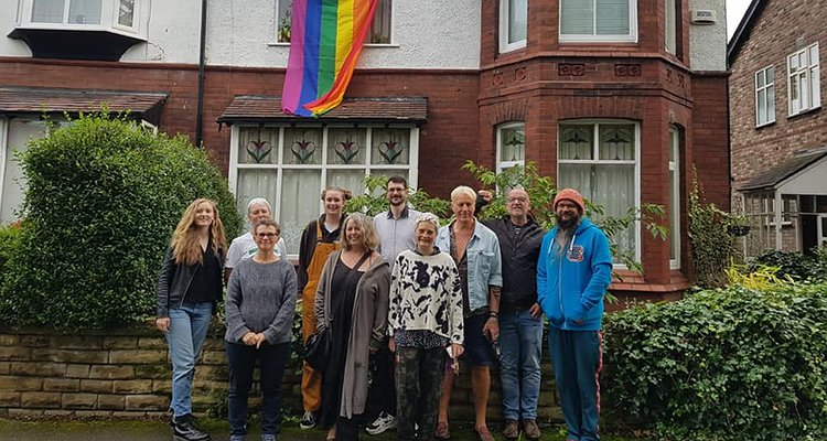Man suffers homophobic abuse after flying Pride flag from house - neighbours respond by all doing the same